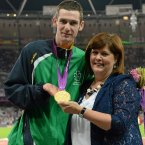3 September 2012; Ireland's Michael McKillop, from Newtownabbey, Co. Antrim, who was presented with his gold medal by his mother Catherine after winning the men's 1500m - T37 final in a time of 4.08:11. London 2012 Paralympic Games, Athletics, Olympic Stadium, Olympic Park, Stratford, London, England. Picture credit: Brian Lawless / SPORTSFILE