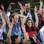 The Duke and Duchess of Cambridge take part in a Mexican wave as they watch cycling in the Velodrome at the Paralympic Games in Stratford, London. PRESS ASSOCIATION Photo. Picture date: Thursday August 30, 2012. See PA PARALYMPICS stories. Photo credit: Stefan Rousseau/PA Wire