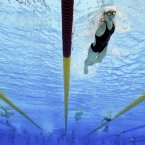 Swimmers train in the Aquatic Center ahead of the 2012 Paralympics, Tuesday, Aug. 28, 2012, in London. (AP Photo/Kirsty Wigglesworth)