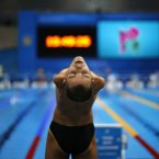 Ukraine's Laroslav Semenenko stretches ahead of Men's 100m Backstroke S6 category at the 2012 Paralympics Olympics, Thursday, Aug. 30, 2012, in London. (AP Photo/Emilio Morenatti)