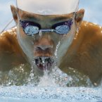 Tomotaro Nakamura of Japan swims in at the 2012 Paralympics games, Saturday, Sept. 1, 2012, in London. (AP Photo/Alastair Grant)