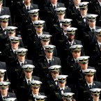 Members of the Navy Midshipmen take to the field before the game.  INPHO/James Crombie