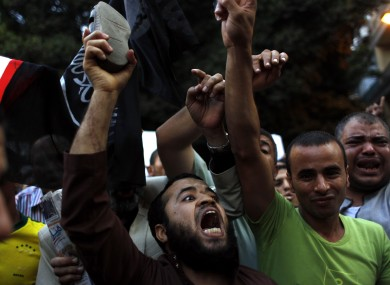 Egyptian protesters chant anti-U.S. slogans during a demonstration in front of the U.S. embassy in Cairo, Egypt, Wednesday, Sept. 12, 2012 as part of widespread anger across the Muslim world about a film ridiculing Islam's Prophet Muhammad.