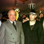 This is a 1998 shot of Harrods owner Mohamed Al-Fayed and Boyzone's Shane Lynch. Oh, and a parrot. 