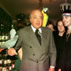 This is a 1998 shot of Harrods owner Mohamed Al-Fayed and Boyzone's Shane Lynch. Oh, and two parrots. 