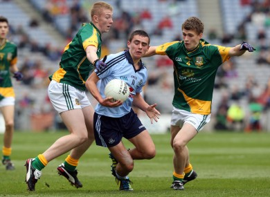 Niall Scully of Dublin with Brian Power and Shane Gallagher of Meath.