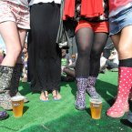 One optimistic fan wears a pair of sandals among the wellies Photo: Laura Hutton/Photocall Ireland