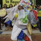 We know that the plastic bag tax has led to fewer of them being used and discarded. But we admit that we miss making whimsical fancy dress from our excess bags like this lady. (AP Photo/Aaron Favila)