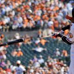 Baltimore Orioles' Wilson Betemit breaks his bat as he hits a foul ball during the first inning of a baseball game against the Tampa Bay Rays in Baltimore.