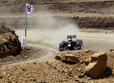 Former Formula One driver David Coulthard pilots the Red Bull Show Car through in testing.