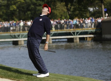 USA's Bubba Watson reacts after a bunker shot on the 13th hole.