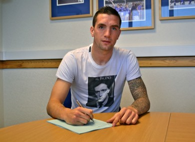 Duffy signs his new deal.