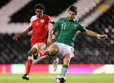 Ireland's Shane Long and Raed Saleh of Oman.