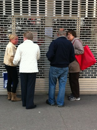 Shoppers outside the closed Guiney and Co. today.