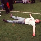 An injured fans lies on the Hillsbrough pitch (Phil O'Brien/EMPICS Sport)
