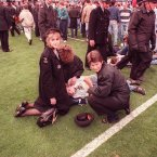St John's Ambulance volunteers tend to injured fans on the pitch (Phil O'Brien/EMPICS Sport)