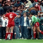 Liverpool goalkeeper Bruce Grobbelaar (r) and Alan Hansen (6) can only watch as the tragic events unfold around them. (Photo: Ross Kinnaird/EMPICS Sport)