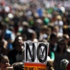Tens of thousands of people from all over the country converged on Madrid to hold a large anti-austerity demonstration on Saturday. By mid-morning several major roads had been blocked as buses unloaded protesters at 10 rendezvous points from which marches began. (AP Photo/Andres Kudacki)