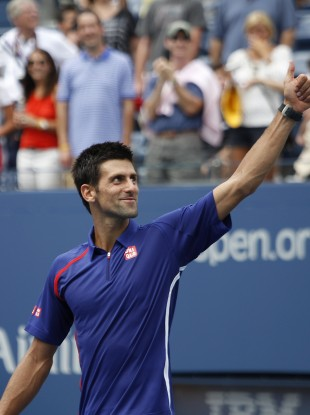 Serbia's Novak Djokovic celebrates winning his match against Julien Benneteau, of France.