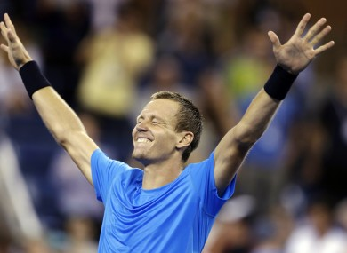 Tomas Berdych, of Czech Republic, reacts after defeating Roger Federer, of Switzerland, in a quarterfinals match at the US Open tennis tournament.