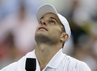 Andy Roddick looks up after loosing to Argentina's Juan Martin Del Potro in the fourth round the 2012 US Open tennis tournament.