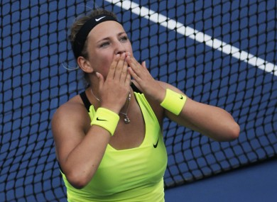 Victoria Azarenka, of Belarus, blows kisses to the crowd after her match against Maria Sharapova, of Russia.