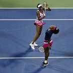 Venus and Serena Williams react to a missed shot. (AP Photo/Charles Krupa)