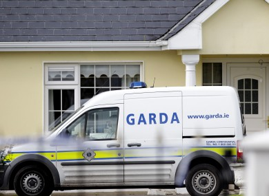 Gardai outside the house in Harrison Place, Charleville, Co Cork on Monday.