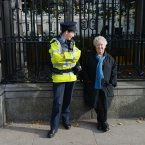 Author and broadcaster Nell McCafferty speaks to a Garda at the rally outside Leinster House.