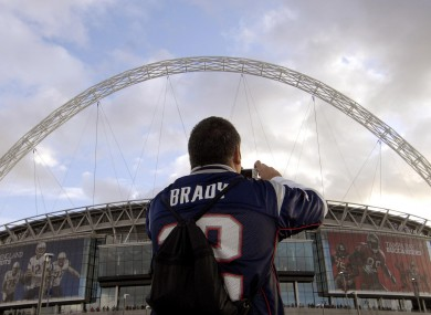 A fan of Tom Brady of the New England Patriots takes a picture on Wembley Way in 2009.