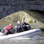 Police officers in boats searching the river Dyfi. Image: Peter Byrne/PA Wire