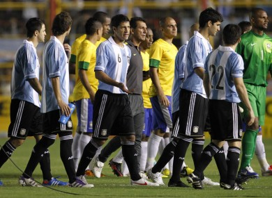 Brazil's players and Argentina's players after their friendly soccer match was suspended due to a partial blackout.