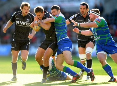 Ashley Beck of Ospreys is tackled by Robbie Henshaw of Connacht.