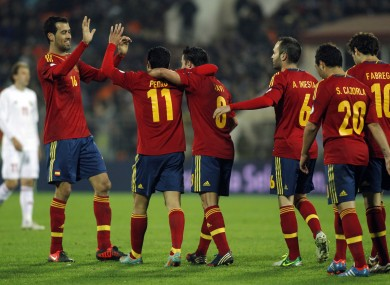 Spain's players celebrate Pedro Rodriguez's score during a World Cup 2014 Group qualification match between Belarus and Spain national teams in Minsk.