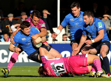 Leinster's Brian O'Driscoll tackled by Jason Shoemark and Phil Dollman of Exeter.
