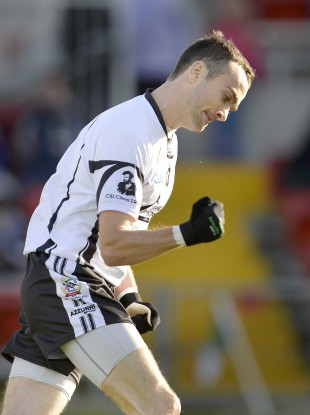 Conor Laverty celebrates his goal for Kilcoo.