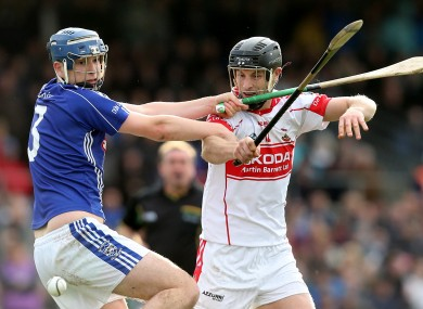 Dungarvan's Derek Barry and Jack Kennedy of De La Salle clash in last Sunday's Waterford Senior Hurling Final.