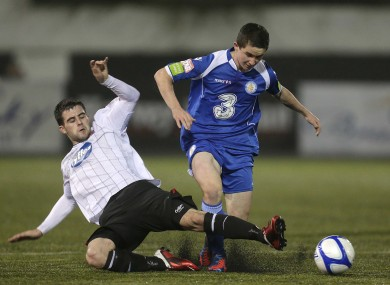 Dundalk's Eoghan Osborne slides in on Man of the Match Sean Maguire.