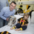 Noresiders' skipper Eoin Larkin with Tadgh French,2, from Kilkenny city.
