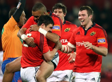 Felix Jones celebrates with Simon Zebo and Peter O'Mahony.