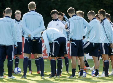 German coach Joachim Loew center, adresses his players during a training session yesterday.