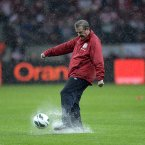 Roy Hodgson, less than impressed with the waterlogged pitch in Warsaw.