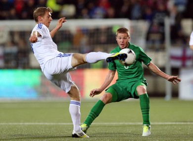 Ireland's James McCarthy and Frodi Benjaminsen of Faroe Islands tonight.