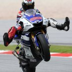 MotoGP rider Jorge Lorenzo from Spain does wheelie after the qualifying session for the Malaysian Motorcycle Grand Prix in Sepang, Malaysia, Saturday, Oct. 20, 2012