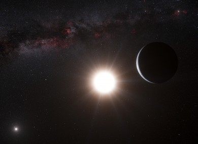This artist's impression made available by the European Southern Observatory on Tuesday, Oct. 16, 2012 shows a planet, right, orbiting the star Alpha Centauri B, center, a member of the triple star system that is the closest to Earth.