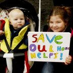 Ollie Martin, nine months, and Ciara Campbell, 11, from Wicklow at the protest (Julien Behal/PA Wire)