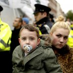 Colm Gray, two, and his mother Edel Gray at the protest (Julien Behal/PA Wire)