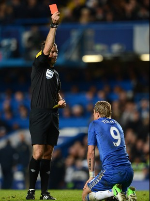 Chelsea's Fernando Torres is shown the red card and sent off by referee Mark Clattenburg on Sunday.