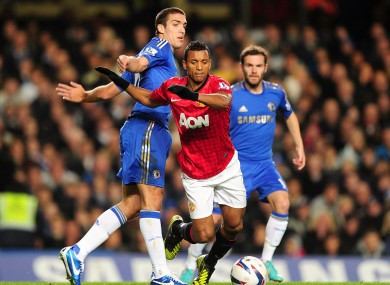 Manchester United's Luis Nani (centre) is fouled by Chelsea's Oriol Romeu (left).