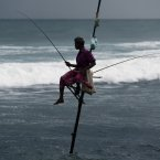 A Sri Lankan traditional fisherman, also known locally as a stick fisherman, sits perched on a stilt fixed into the ocean floor as he fishes in Habaraduwa, about 125 kilometres south of Colombo, Sri Lanka. (AP Photo/Eranga Jayawardena)